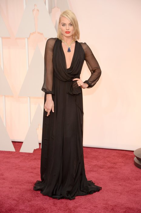 margot robbie in a black gown at oscars