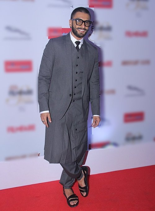 ranveer singh in three piece suit with a skirt and trousers