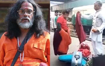 OMG! Swami Om Changes Clothes Right In The Middle Of Delhi Railway Station!