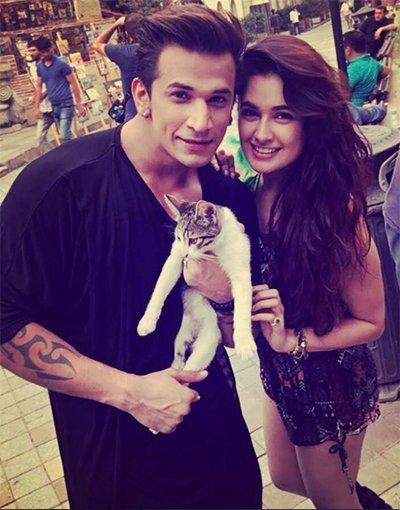 prince narula and yuvika choudhary with cat at a shoot in georgia