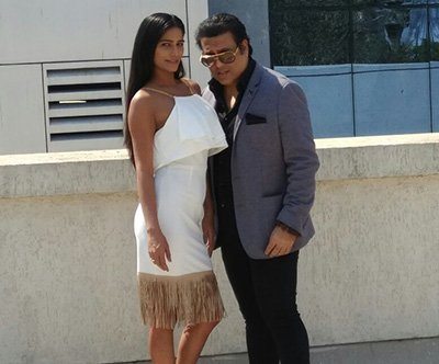 govinda and poonam pandey pose for the media