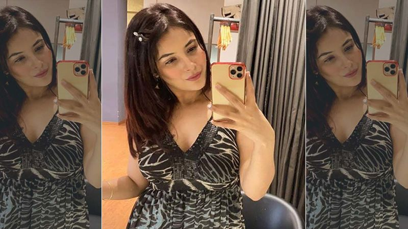 Shehnaaz Gill Shares Some Candids From Canada; Looks Pretty In An Off Shoulder Black Number As She Romances The Camera
