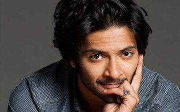 Ali Fazal On Top Of A Bus