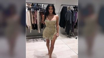 Kim Kardashian Gives Fans A Sneak-Peek Into Her Closet; Strikes A Sexy Pose In The 'Dress Fittings' Picture