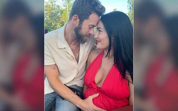 Nikki Bella Welcomes Her First Child With Fiancé Artem Chigvintsev; Couple Share A Family Pic Holding Hands With The Little One
