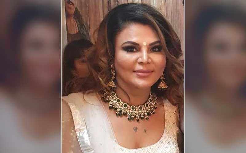 Bigg Boss 14's Rakhi Sawant Is Spotted Walking, Wearing A PPE Suit In Andheri; 'Meri Maa Ko Dekhne Jaane Ke Liye Aise Kapde Mein Jaana Padta Hai'