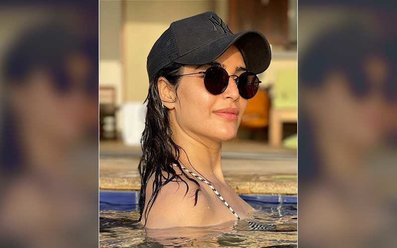 Karishma Tanna Exudes Summer Vibes As She Takes A Dip In The Pool On A Sunny Day; Calls Herself 'Pool Holic'