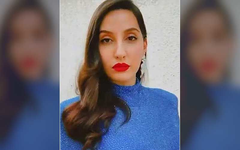 Nora Fatehi Gets Trolled For Her Walk In A Bright Pink Saree Amidst Heavy Mumbai Rains; Netizens Ask, 'Why is She Walking Like That?'