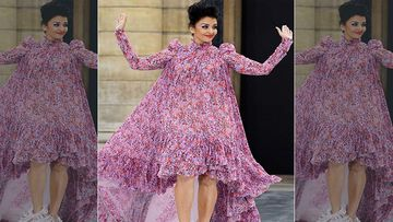Aishwarya Rai Bachchan Makes A Breathtaking Appearance At Paris Fashion Week That Is All About Winks And Kisses; Video Inside