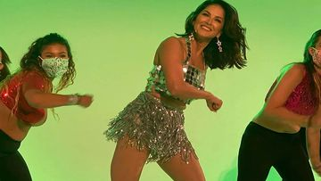 Sunny Leone Resumes Work, Dons A Sexy Shimmery Mini Dress As Background Artists Dance Away In Masks