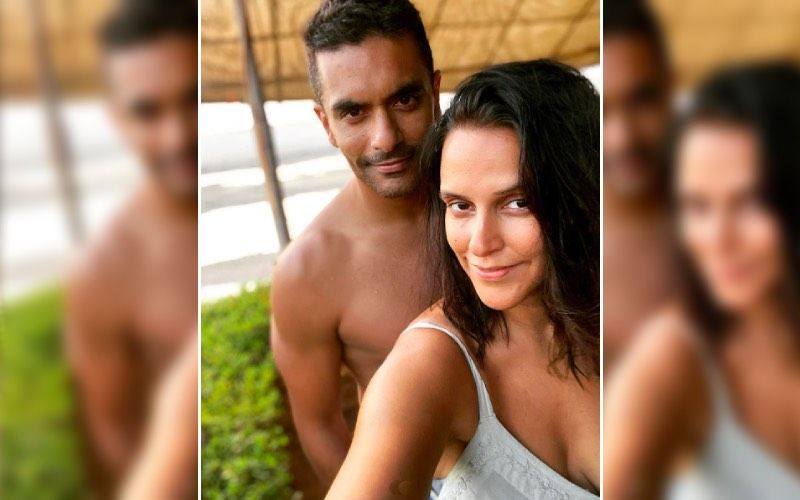Preggers Neha Dhupia Shows Us 'The Balancing Act Between Being Pregnant And Stilettos' In A Cute BTS Photoshoot With Husband Angad Bedi- Watch
