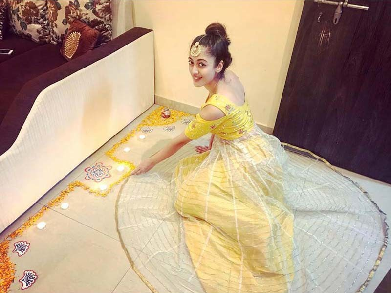 Aditi Sharma Poses With Her Rangoli