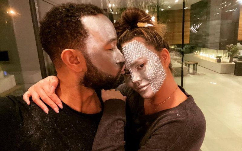 John Legend Has A Very Naughty Reaction To Wife Chrissy Teigen's 'F*** It' Pic Cuddling Their Pet In A Bralette; Leaves The Latter Speechless