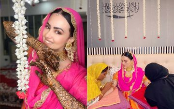 Mrs Mufti Anas AKA Sana Khan Shares Her Mehendi Ceremony Pictures Looking All Demure And Breathtaking In Pink And Orange
