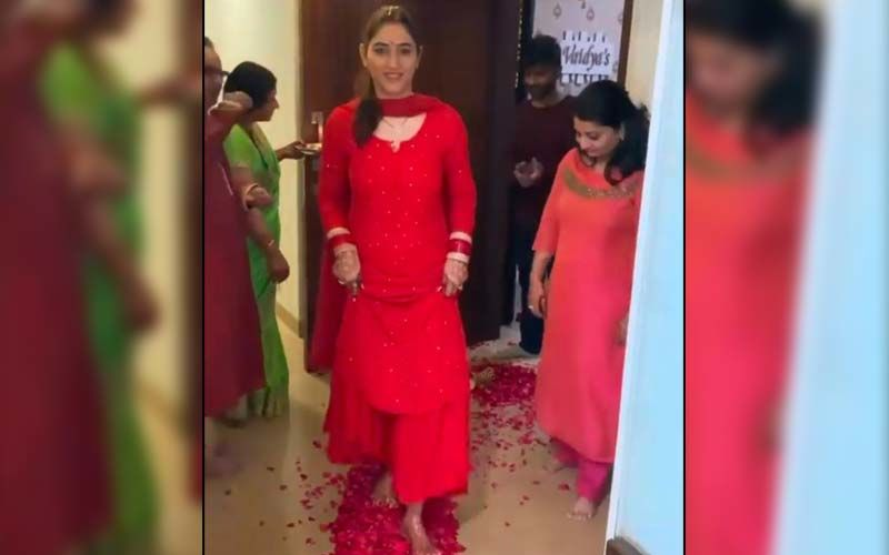Rahul Vaidya's Wife Disha Parmar Receives A Warm Welcome During Her 'Griha Pravesh' Ceremony; Actress Looks Magnificent In A Red Outfit