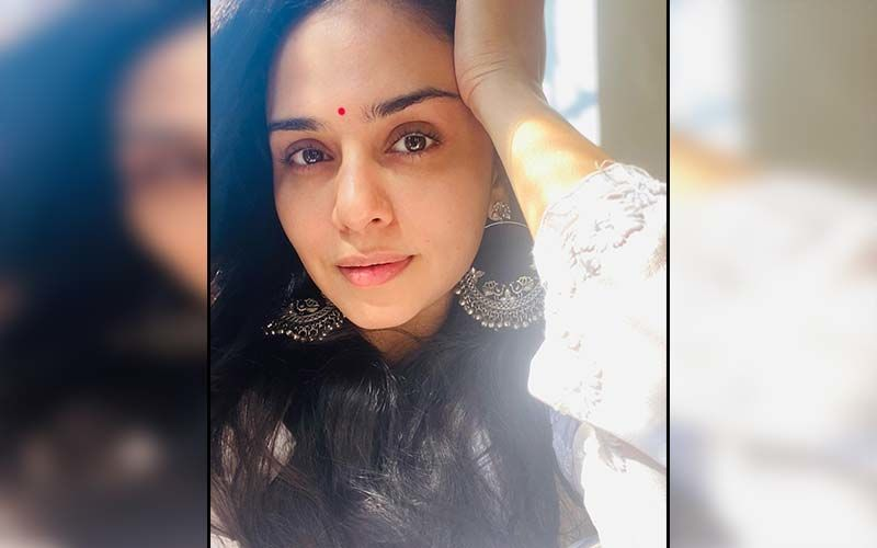 Amruta Khanvilkar Rocks A Stunning T-shirt Dress With Her Long Curly Tresses In A Bewitching Look