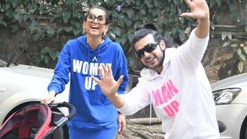 Anusha Dandekar And Karan Kundra Take Their Little One For A Morning Stroll; Sport Matching Slogan Tees