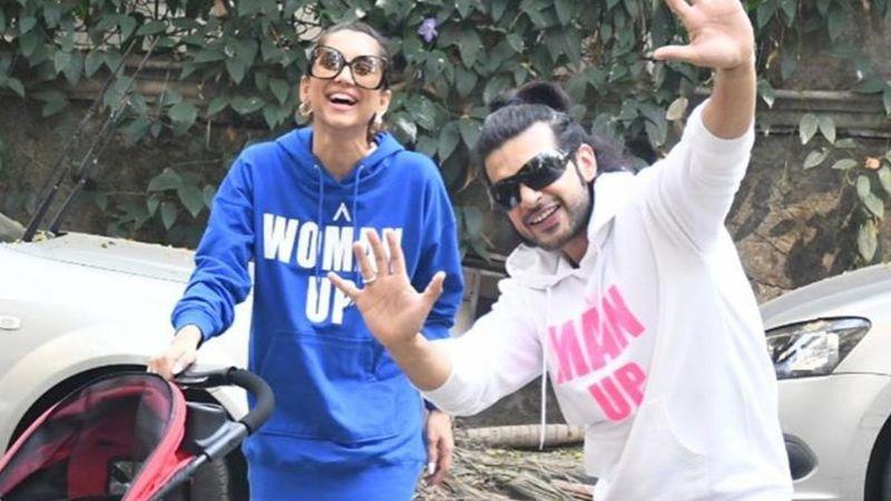 Anusha Dandekar And Karan Kundra Take Their Little One For A Morning Stroll; Sport Matching Slogan Tees
