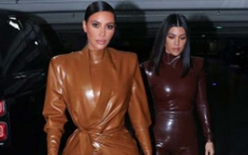 Kim And Kourtney Kardashian Go Top-To-Toe In Latex For Kanye's Sunday Mass; Fans Call Them 'WALKING CONDOMS'