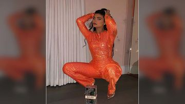 Kylie Jenner Welcomes October With A Shimmery Orange Jumpsuit And A Dollar Clutch