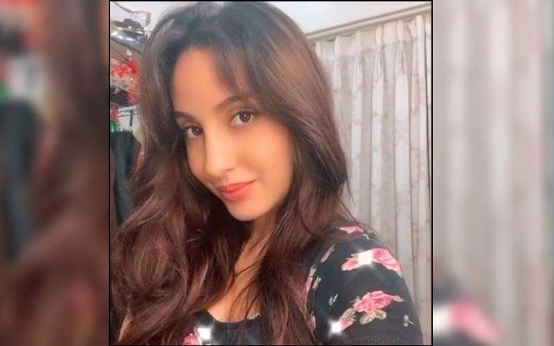 Nora Fatehi's Fan Gets Her Face Tattooed On His Arm; Here's How The Actress Reacted - WATCH