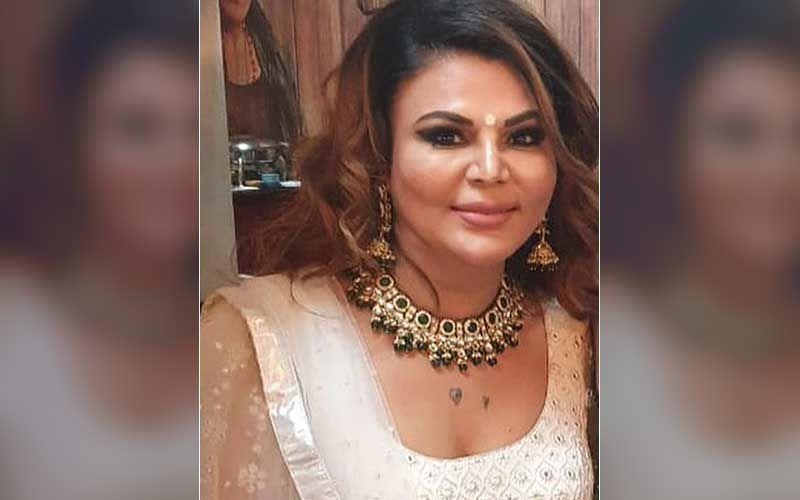 Rakhi Sawant Enjoys Mumbai Rains As She Sings And Dances To 'Tip Tip Barsa Paani', Fans Call Her 'Queen Of Entertainment' - WATCH