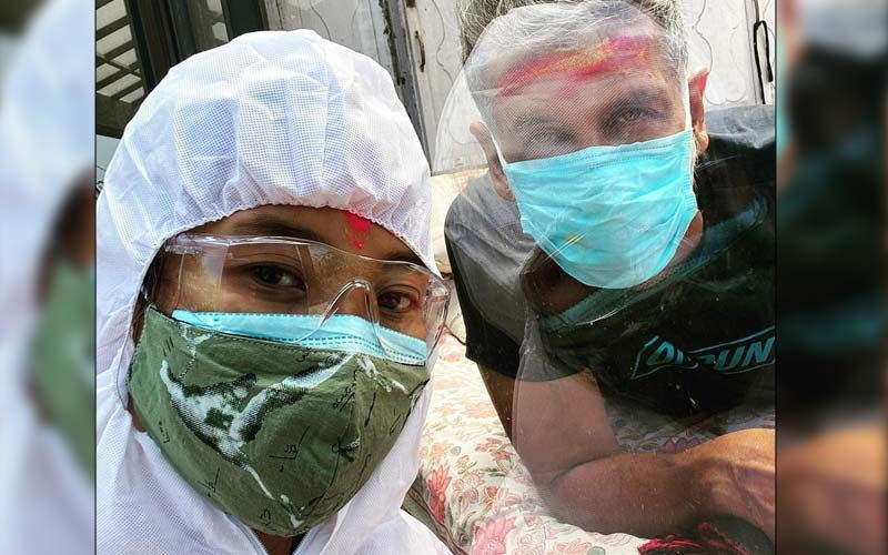 Milind Soman's Wife Ankita Konwar Visits Him Dressed In PPE Kit To Celebrate Holi; Actor Says 'No Hug Though'- PICS