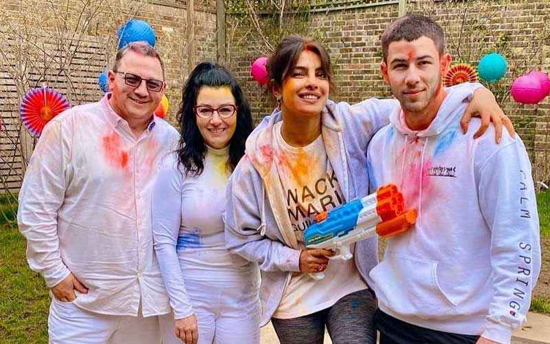 Holi 2021: Priyanka Chopra Jonas Plays With A Funky Water Gun As She Celebrates The Festival Of Colours With Nick Jonas And His Parents - PICS