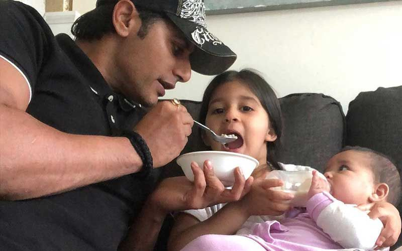 Karanvir Bohra Shares A Cutesy Pic Of Him Feeding His Daughter; Reveals He Chases Twins To Feed Them, Asks, 'Ok At What Age Does This Stop?'