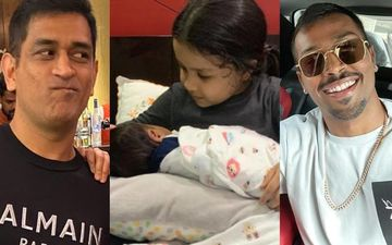 MS Dhoni's Wifey Sakshi Posts A Pic Of Little Ziva Holding A Newborn; Fans Are Confused If The Baby's Jr Hardik Pandya Or Jr Dhoni