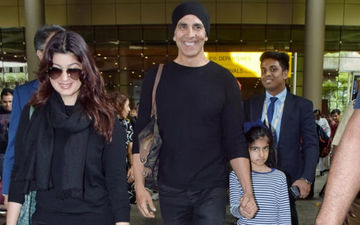 Twinning In Black Akshay Kumar And Twinkle Khanna Return To Mumbai With Li'l Nitara