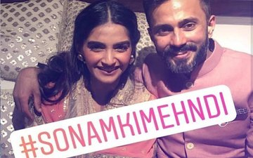 Mehendi Pics: Sonam Kapoor & Anand Ahuja Look Gorgeous In Colour-Coordinated Outfits
