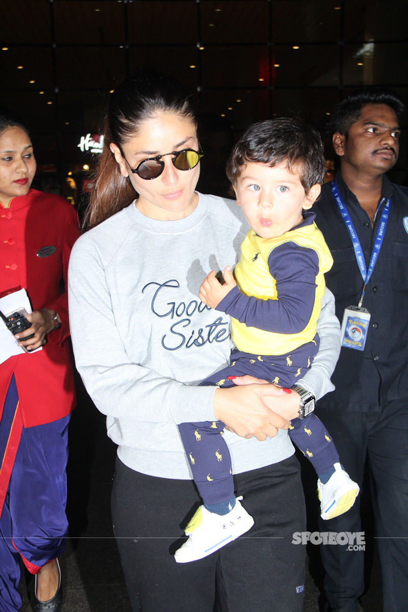 Taimur Smiles At The Shutterbugs As Mommy Kareena Kapoor Carries Him Out Of The Airport