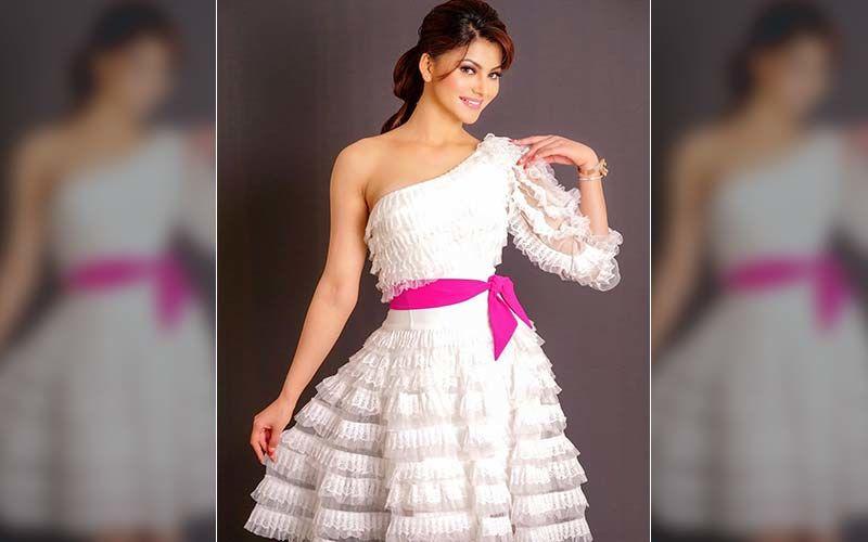 Urvashi Tells How Not To Do Ruffles In White One-Shoulder Dress