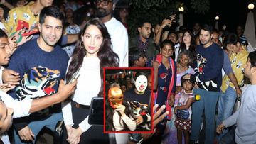 Masked Varun Dhawan Tightly Holds Nora Fatehi's Hand At Mt Mary Church; Actors Invite Crazy Attention, Get Mobbed – VIDEO