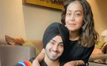 Preggers Neha Kakkar And Rohanpreet Singh's Latest Airport Pic Leave Fans Confused; Raise Question Over Her Baby Bump Saying 'She's Not Looking Pregnant'