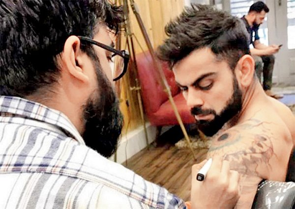 Virat Kohli Getting Tattoed