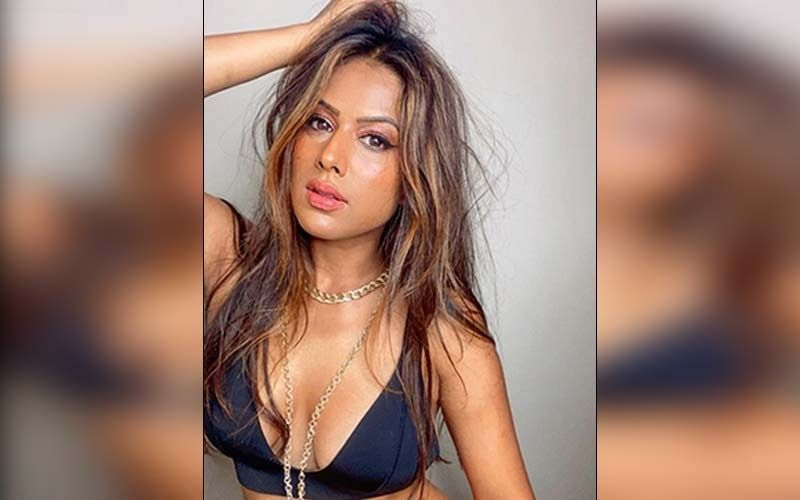 Nia Sharma Flaunts Her Curvy Figure In A Black Cleavage Popping Outfit And Leaves Internet Gasping For Breath; See PHOTOS