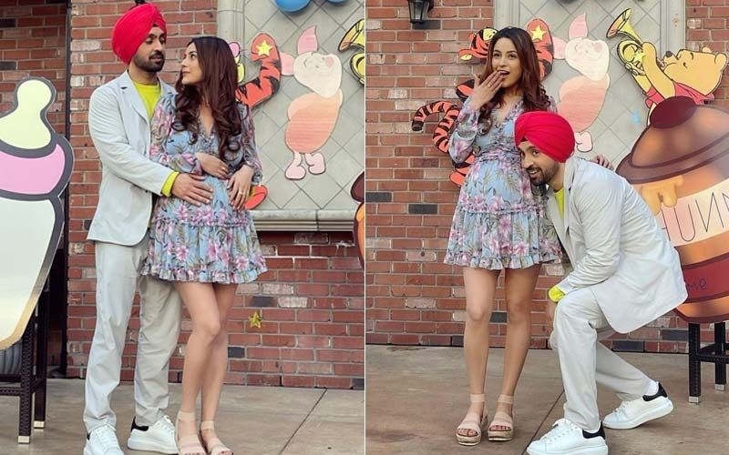 OMG: Shehnaaz Gill Flaunts Her Baby Bump As Diljit Dosanjh Caresses It; New Stills From Canada Are Too Cute To Handle