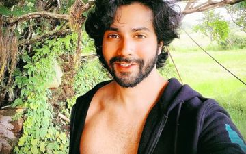 Varun Dhawan Flaunts His Sexy Bod Wearing Only Cargo Shorts As He Chills Like A Boss At A Beachy Destination; Fans Say 'Haye Garmi' – See Pic