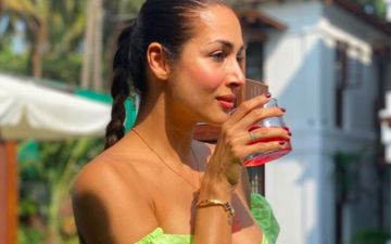 Malaika Arora Wears A Flirty Green Bikini Sipping On A Drink As She Tells Us How All Sundays Should Look Like; It's All Easy-Peasy-Breezy