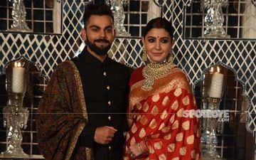 IPL 2021: Anushka Sharma And Virat Kohli Clicked At Airport With Daughter Vamika As They Return To Mumbai; The Pink Bow Is All We Get To See