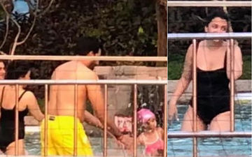 Aishwarya Rai Bachchan Has A Fun Time With Abhishek Bachchan And Aaradhya In The Pool - View Pics