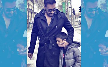 Ajay Devgn Gets Trolled For Smoking Next To His Son