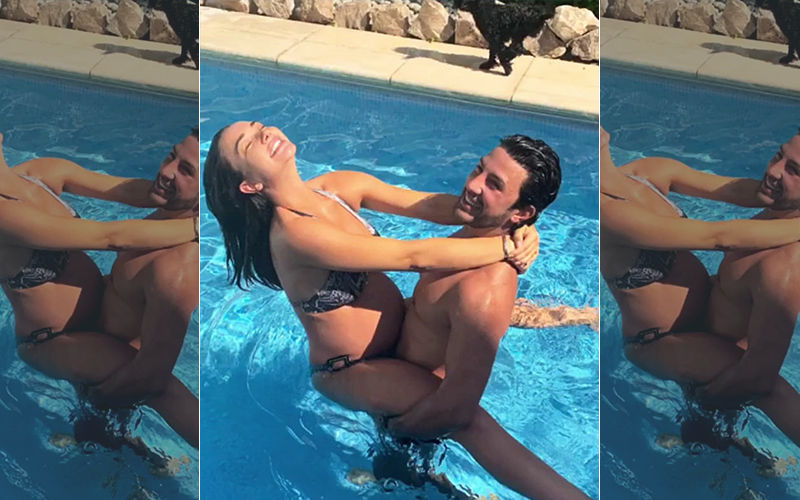 A Preggers Amy Jackson Raises The Mercury Levels In These Pool Pictures With Her Fiancé George Panayiotou