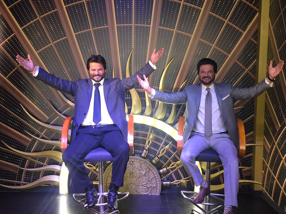 anil kapoor at the madame tussards posing with the statue