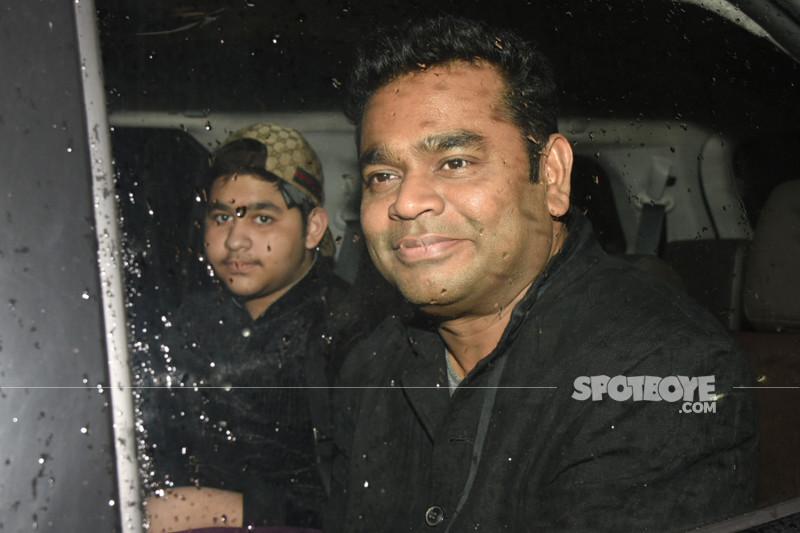 ar rahman poses for the media