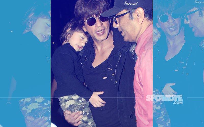 Shah Rukh Khan Lovingly Carries A Sleepy AbRam At The Mumbai Airport