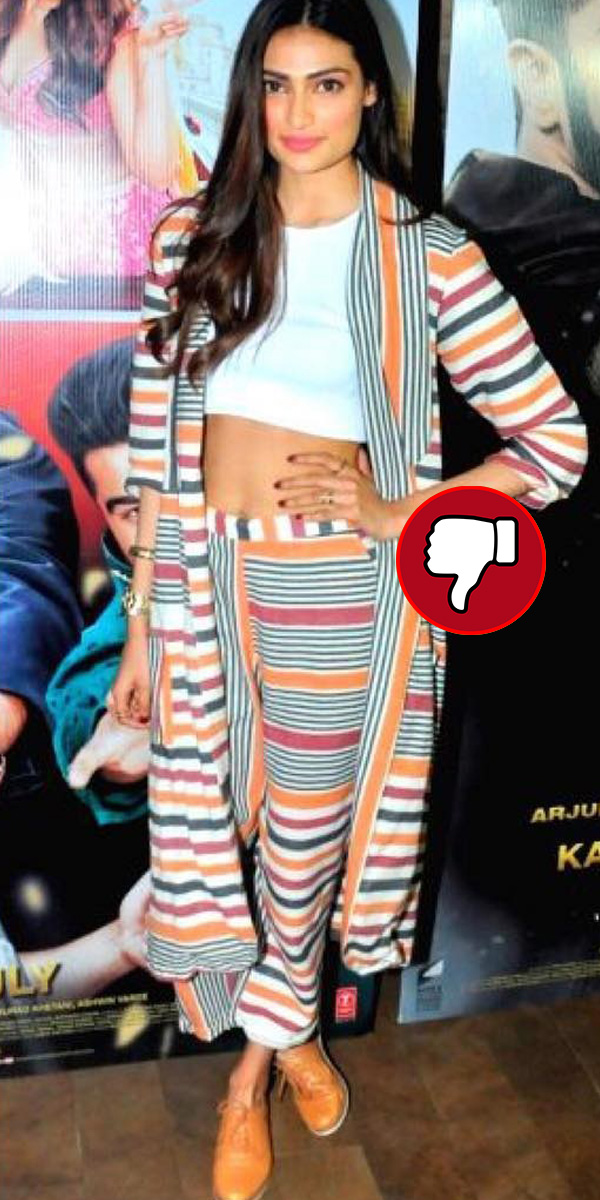 athiya shetty disappoints in a multi colour striped pant suit