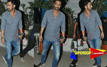 Arjun Rampal leaves restaurant with an alcohol bottle in hand!